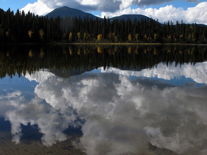 The Quesnel Highlands reflected in the Spectacle Lakes.