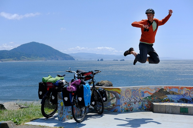 Jumping for joy back on the coast at Port Orford. (photo by Christoph Hšhmann)
