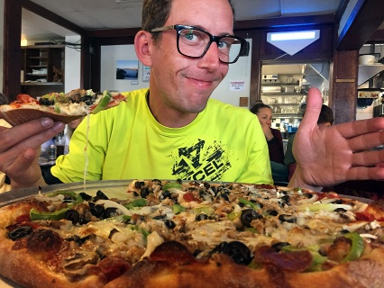 Forgetting he's in America, Christoph orders the medium pizza for himself at the Avenue Cafe in Miranda. We ate the other half for dinner that night.