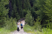 Jan and Lawrence riding on to another trestle bridge west of Osprey Lake.