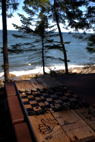 Somebody left us a chess game made of driftwood and stones.