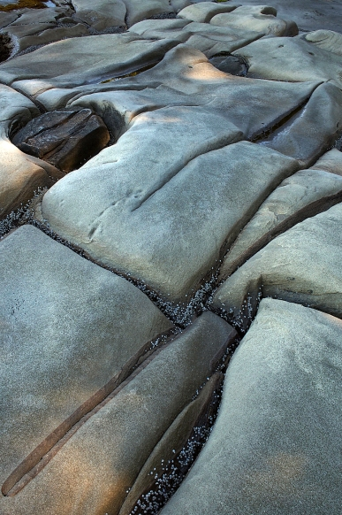 Erosional patterns in the rocks at Dinisio Point.