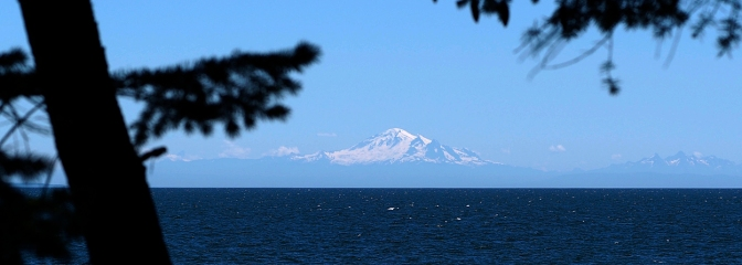 Mount Baker looms on the horizon 130 km away.