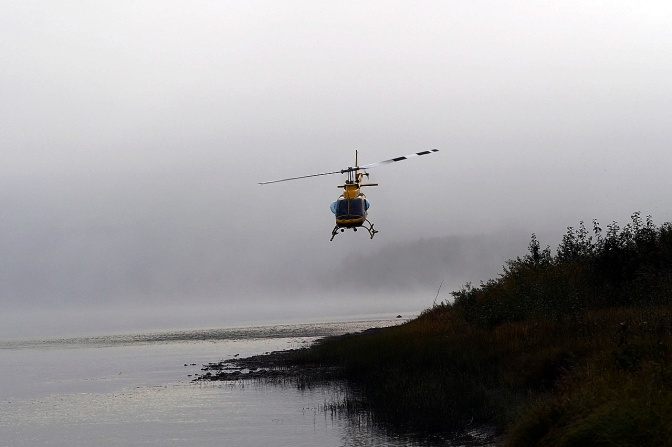 The RCMP helicopter searching for two lost paddlers.