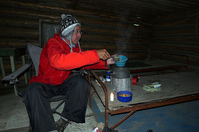 Cooking dinner inside the cabin at the mouth of the White River.