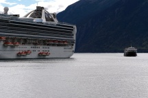 Our ferry to Haines is dwarfed by one of the cruise ships.