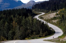Just across the border into Canada, the road climbs to the Haines Highway summit
