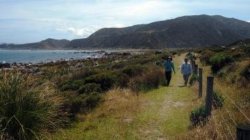 Jan and Enid hiking along the coast near Wellington